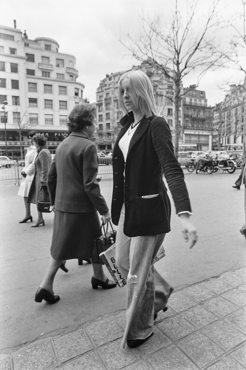 Pedestrians in the streets of Paris, France in 1973